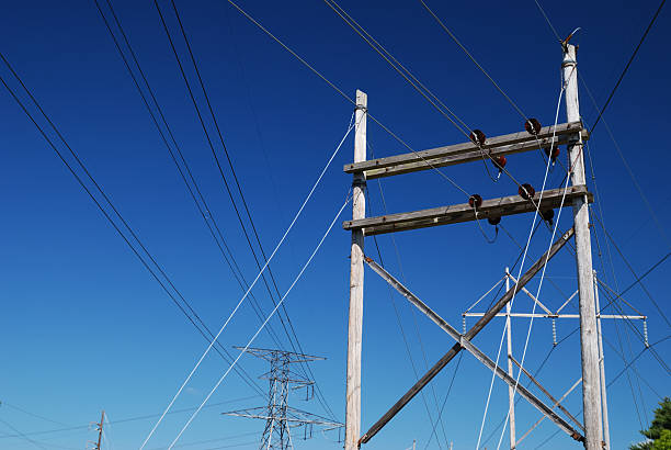 Complex power lines converging stock photo