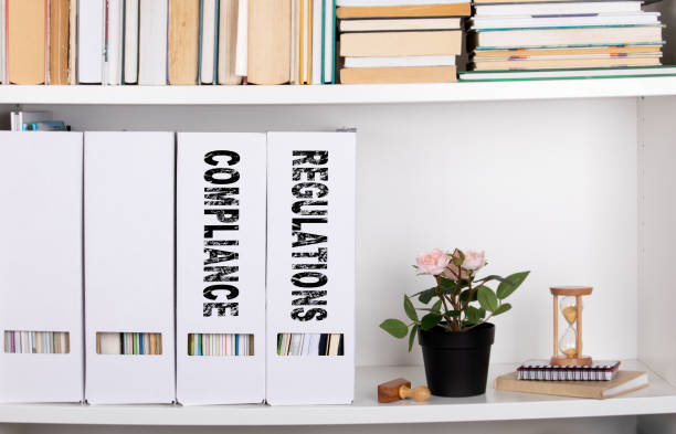 Compliance and Regulations concept. document folders and organizers stock photo