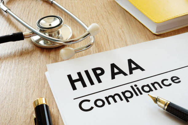 HIPAA Compliance application and stethoscope on a desk. HIPAA Compliance application and stethoscope on a desk. military private stock pictures, royalty-free photos & images