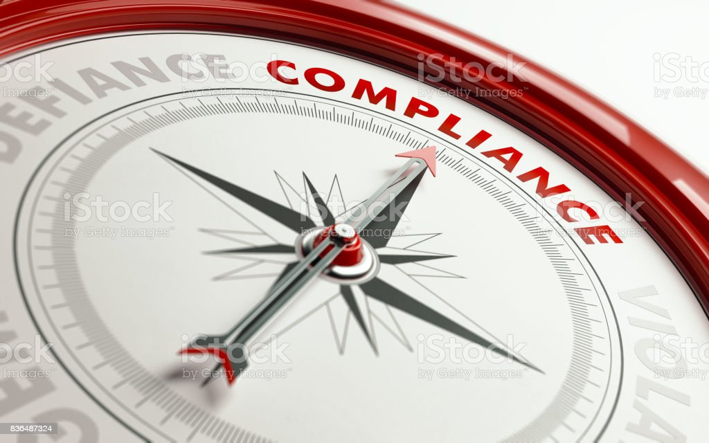 Compliance Concept: Arrow of A Compass Pointing Compliance Text stock photo