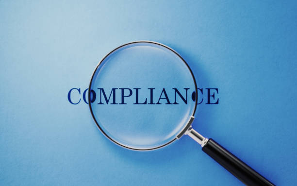 Compliance Concept - Magnifier And Compliance Text On Blue Background Magnifier and compliance text on blue background. Horizontal composition with copy space. anonymous stock pictures, royalty-free photos & images