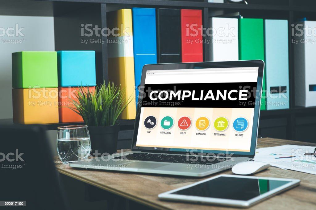 Compliance Concept on Laptop Screen stock photo