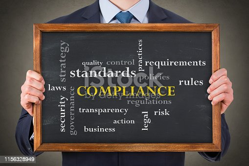 464906632 istock photo Compliance Concepts on Chalkboard Background 1156328949