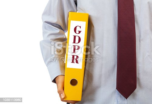 937370192 istock photo GDPR compliance. Manager holding a folder on white background, text GDPR, clipping path 1035113980