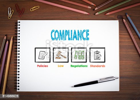 464906632 istock photo Compliance. Notebooks, pen and colored pencils on a wooden table 814988628