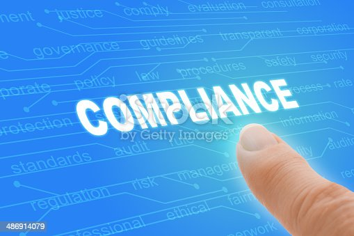 istock Compliance Regulations Computer Words with Finger Closeup 486914079