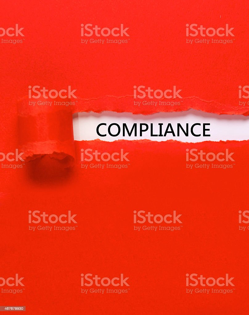 Compliance under torn paper stock photo