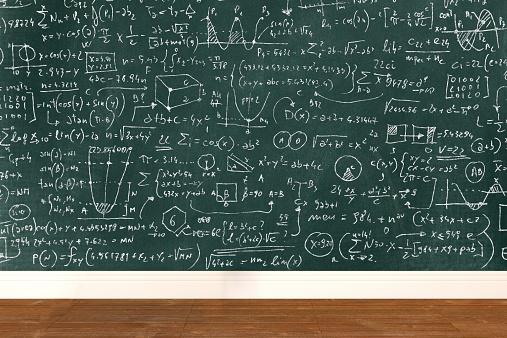Complicated math formula on school classroom blackboard