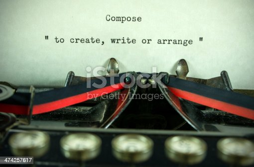 An antique typewriter with the definition of the word