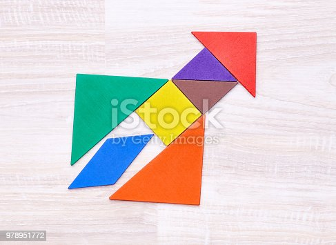 istock Composed figures into shape of rocket 978951772