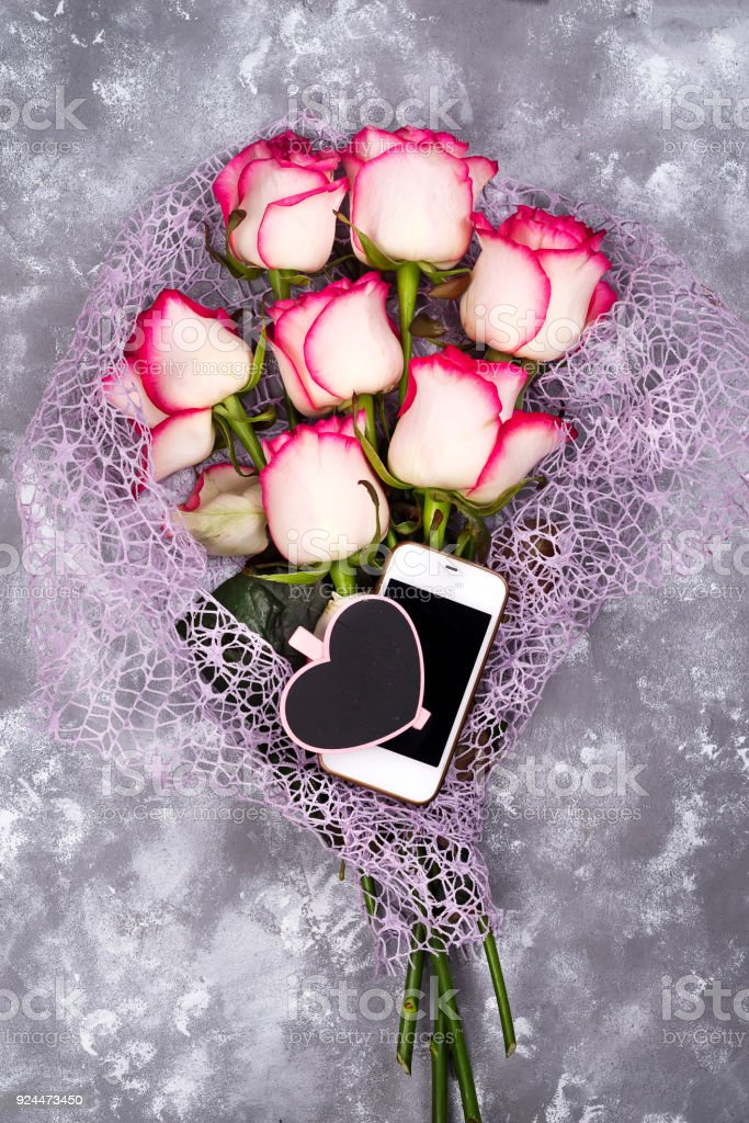 composed of the roses and mobile phone adn chalkboard heart stock photo