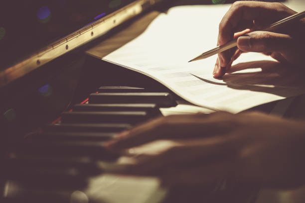 Composer of Music Composer of Music keyboard player stock pictures, royalty-free photos & images