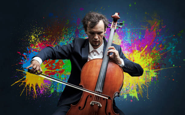 Composer with splotch and his cello Young classical musician with colorful splotch wallpaper passion stock pictures, royalty-free photos & images