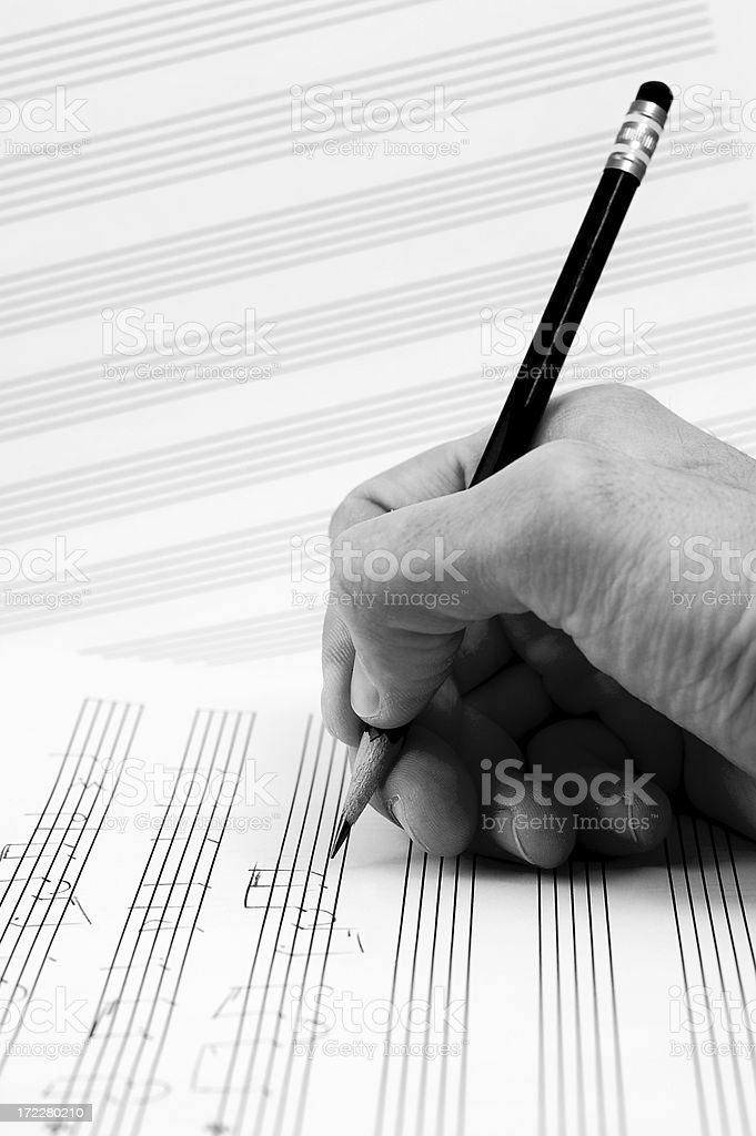 Composer's hand stock photo