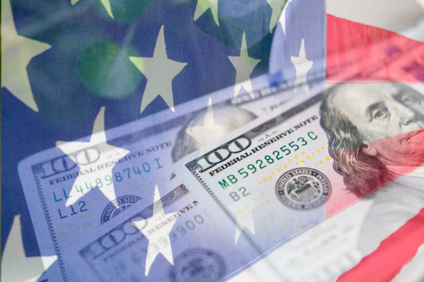 Composite design referencing the American Stimulus checks. Composite design of the American Flag and cash money to depict the Stimulus checks Americans received during the COVID-19 crisis. stimulus check stock pictures, royalty-free photos & images