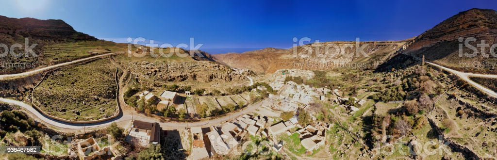 Composite high-resolution panorama of the Dana Village narby the Dana Reserve, a 1000-metre deep valley cut in the south-western mountainous region of the Kingdom of Jordan. stock photo