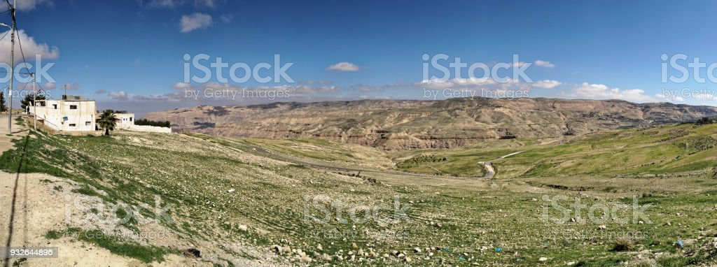 Composite high-resolution panoramic view from the plateau off the Dana Reserve Dana Reserve, an over 1000-metre deep valley cut in the south-western mountainous region of the Kingdom of Jordan. stock photo