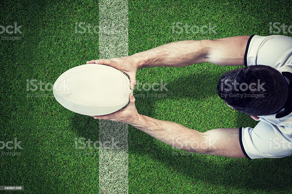 Composite image of a rugby player scoring try stock photo