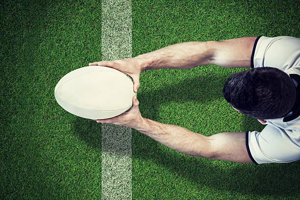 composite-bild von einem rugby-spieler versuchen punkten - rugby stock-fotos und bilder