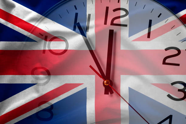 Composite image of British flag and clock stock photo
