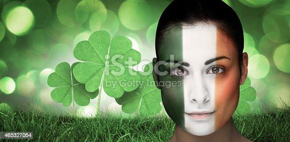 istock Composite image of brunette in irish face paint 465327054