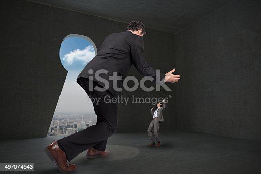 82186105 istock photo Composite image of businessman posing with hands up 497074543
