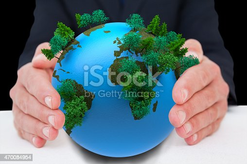 Businessman with hand out  against earth with forest