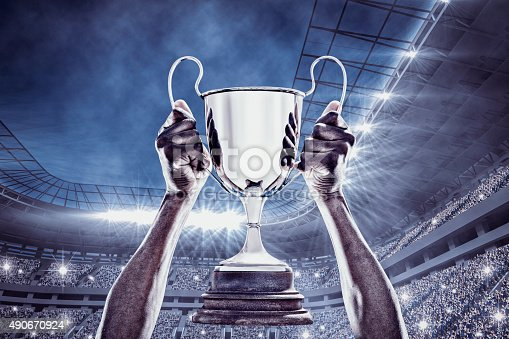 istock Composite image of cheering rugby player with cup 490670924