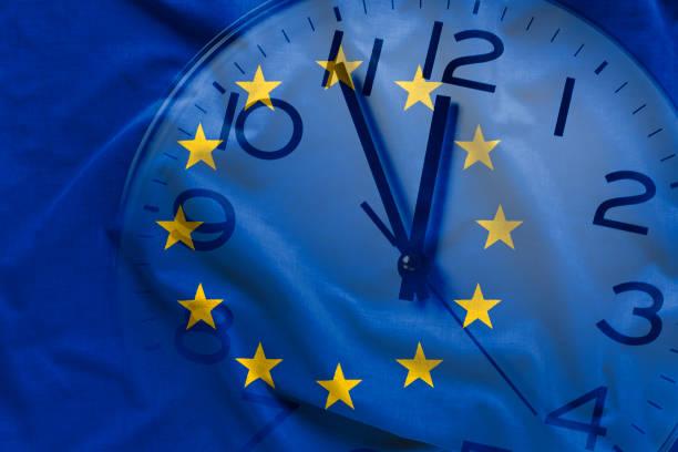 Composite image of EU flag and clock stock photo