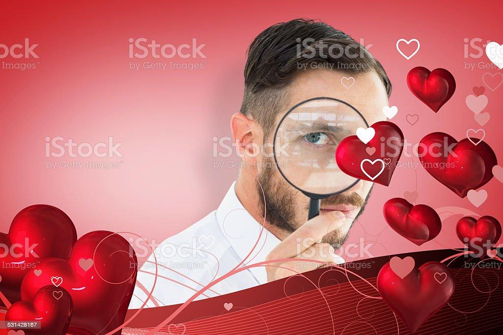 Imagem composta de geeky, empresário, olhando através da lupa - foto de acervo