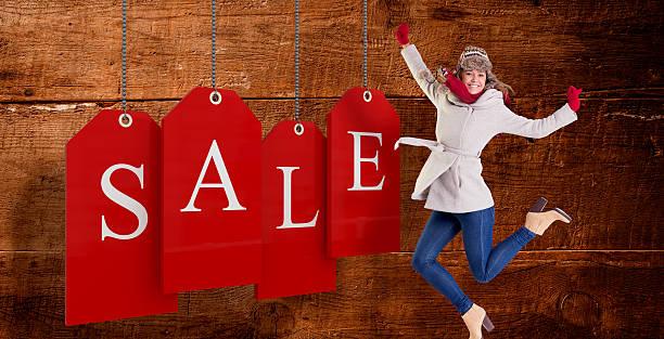 composite-bild von glücklichen blonde in winterkleidung posieren - laminat günstig stock-fotos und bilder