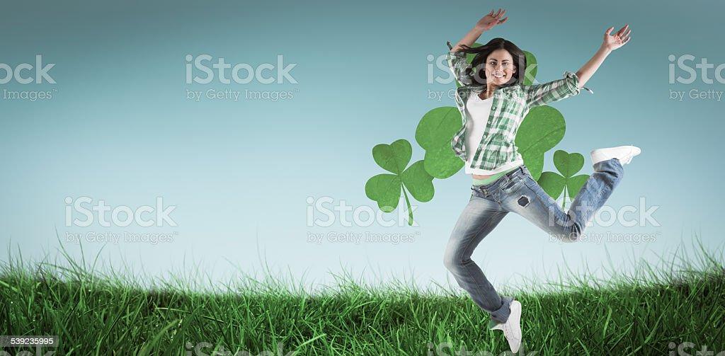 Composite image of happy brunette stock photo
