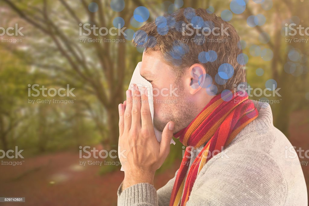 Composite image of man blowing nose on tissue stock photo