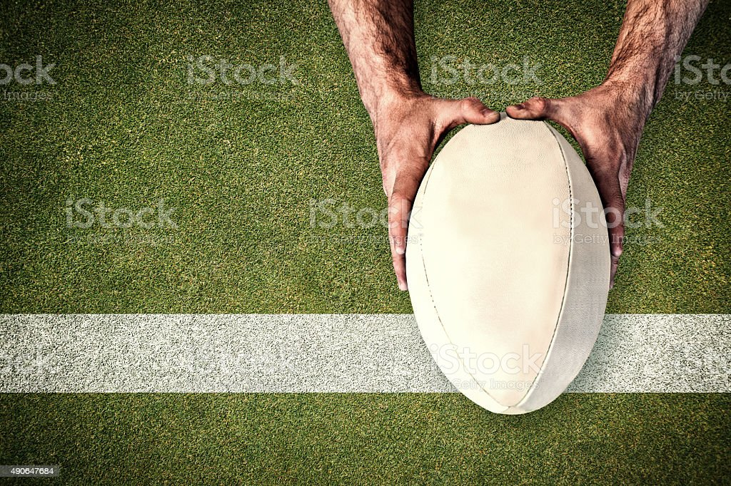 Composite image of man holding rugby ball stock photo