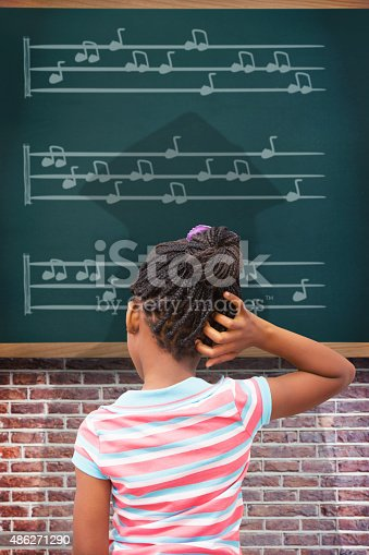 istock Composite image of pupil thinking 486271290