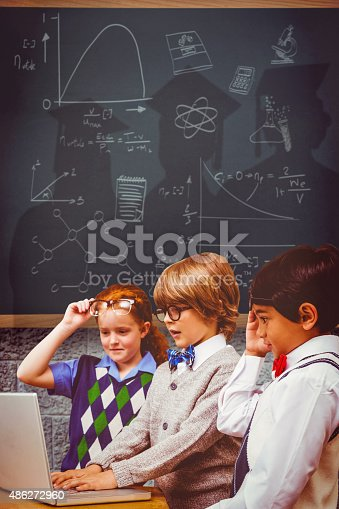 istock Composite image of pupils using laptop 486272960