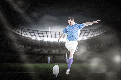 Composite Image Of Rugby Player Doing A Drop Kick Stock