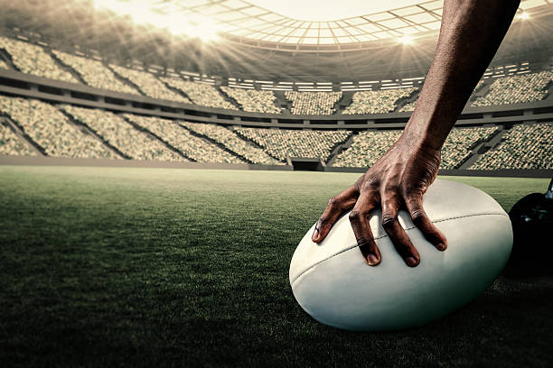 composite-bild der rugby-spieler hält den ball - rugby stock-fotos und bilder