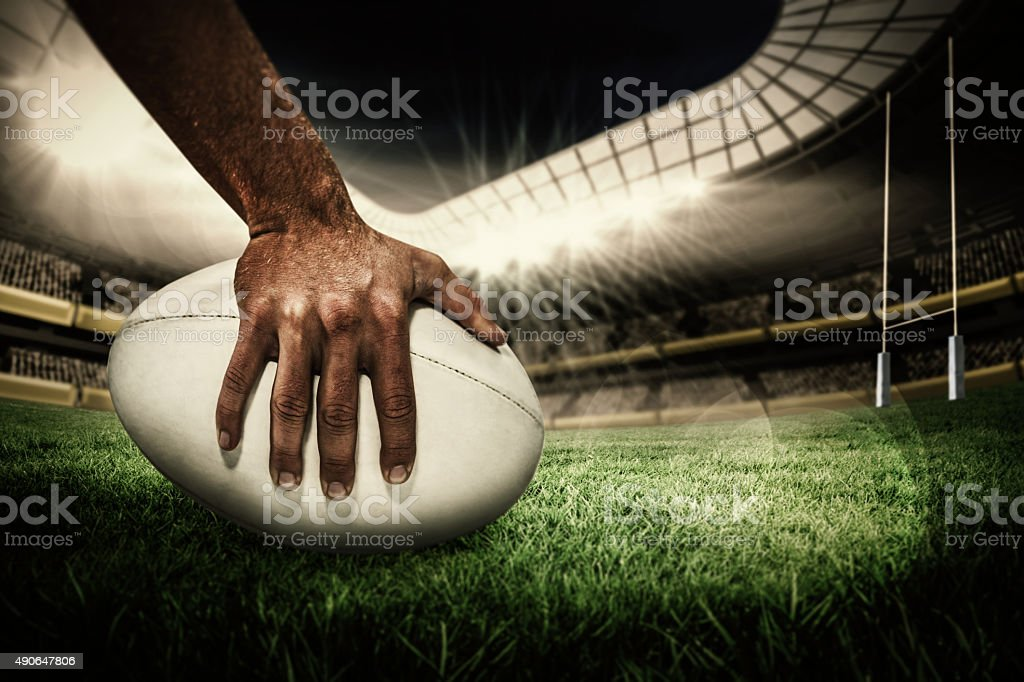 Composite image of rugby player scoring try stock photo