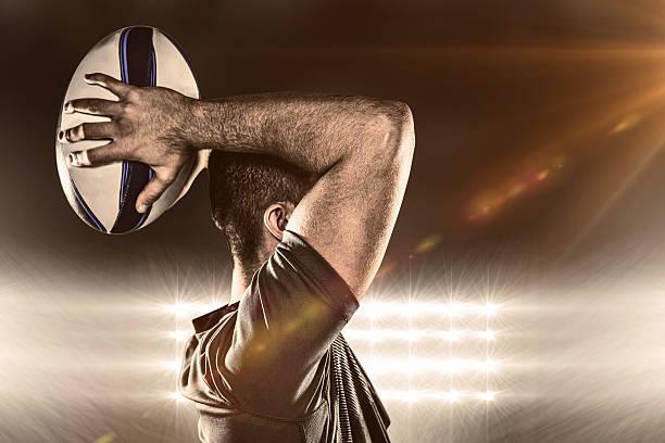 composite-bild der rugby-ball werfen - rugby stock-fotos und bilder