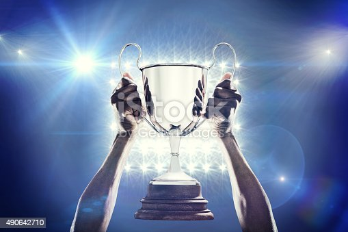 istock Composite image of rugby player with winners cup 490642710