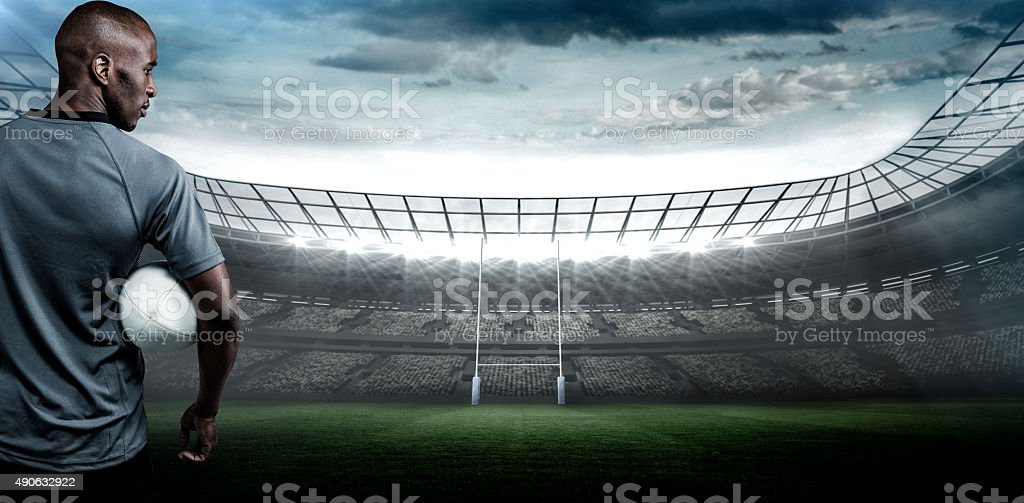 Composite image of serious rugby player stock photo