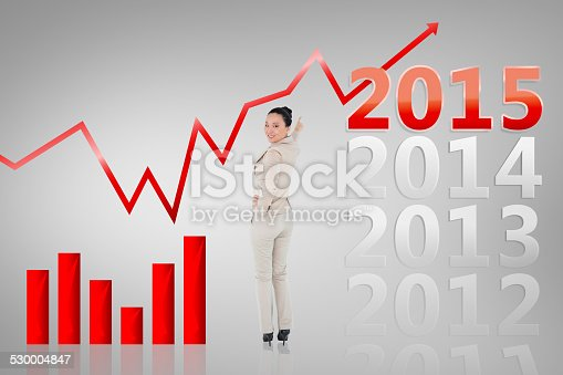 istock Composite image of smiling asian businesswoman pointing 530004847