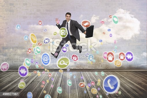 Smiling businessman in a hurry against clouds in a room