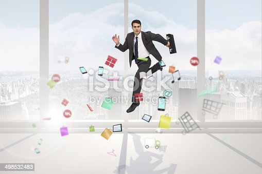 Stern businessman in a hurry against bright white room with windows