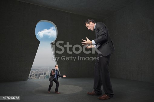 82186105 istock photo Composite image of stressed businessman gesturing over tiny busi 497040755