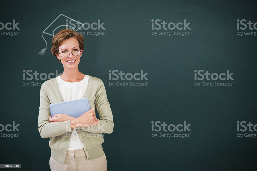 Composite image of teacher holding tablet pc at library stock photo