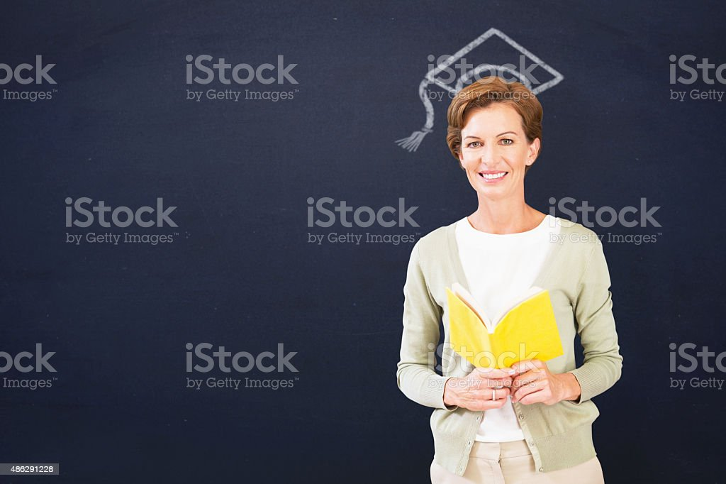 Composite image of teacher reading book at library stock photo
