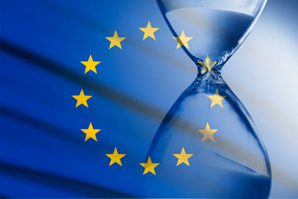 Composite image of the EU flag and hourglass stock photo