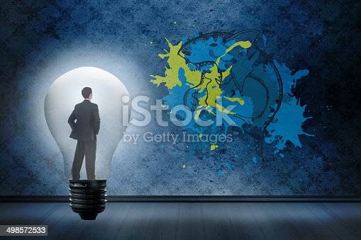Thinking businessman in light bulb against dark grimy room with loan shark graphic